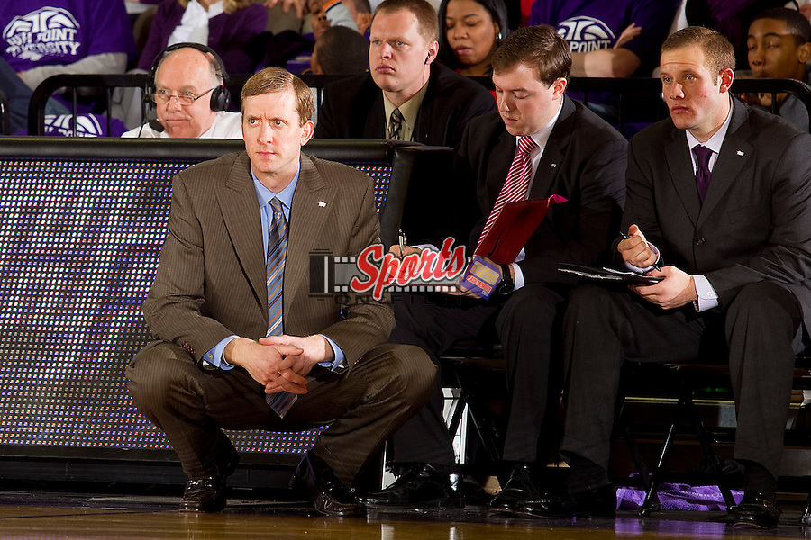 High Point Panthers head coach Scott Cherry watches the action from the sidelines during the second half against the Gardner-Webb Runnin' Bulldogs at Millis Athletic Center on February 4, 2012 in High Point, North Carolina.  The Panthers defeated the Runnin' Bulldogs 81-77 in overtime.   (Brian Westerholt / Sports On Film)