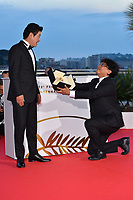 CANNES, FRANCE. May 25, 2019: Bong Joon-Ho & Song Kang-ho at the Palme d'Or Awards photocall at the 72nd Festival de Cannes.<br /> Picture: Paul Smith / Featureflash