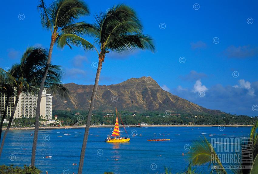 Diamond head with catamaran and outrigger canoe, Oahu