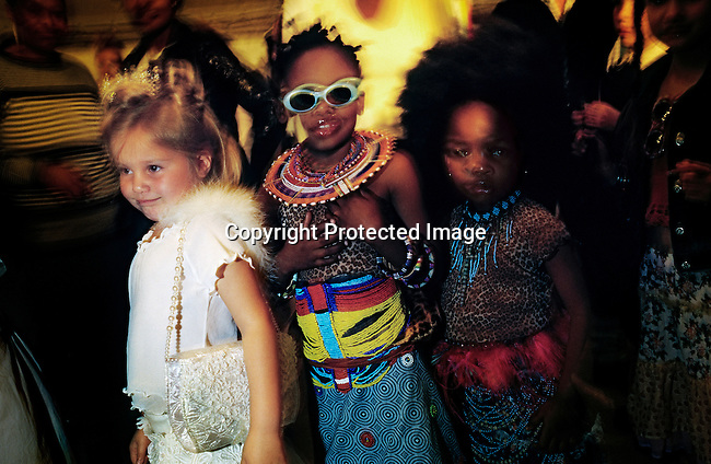 "Child models backstage to enter the stage at a fashion show on August 22, 2002 at Monte Casino about 10 miles north of Cape Town, South Africa. A show showcasing the 24 best of S. Africa's designers and the best models etc. The event named  ""Nederburg Designer Collection"" was attended by fashion editors from some of the top European fashion magazines. (Photo by: Per-Anders Pettersson)"