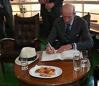 Pictured: Prince Edward signs the visitors' book. Saturday 18 May 2019<br /> Re: Prince Edward, Duke of Kent visits cruiser Georgios Averof at Palaio Faliro, Athens, Greece