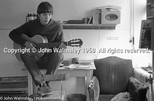 Playing guitar in his room, Summerhill school, Leiston, Suffolk, UK. 1968.