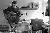 Playing guitar in his room, Summerhill school, Leiston, Suffolk, UK. 1968.