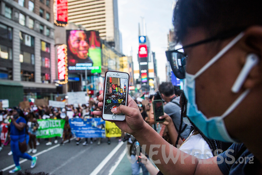 "NEW YORK, NY - JULY 26: A young man takes a photo with his cell phone of the huge crowd of protesters marching in Times Square in New York, NY on July 26, 2020. Hundreds of New York activists participated in a march. to condemn what they see as excessive focus by federal authorities in Portland, Oregon and continue to support the different movements of ""Black Lives Matter"" (Photo by Pablo Monsalve / VIEWpress via Getty Images)"