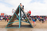 Up and over<br /> ----------------<br /> Watched by a large crowd of spectators, the athletes had to climb over this obsticle just near the finish of the 5km Sandstorm challenge last Saturday on Ballyheigue beach