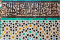 Fes, Morocco.  Medersa Bou Inania, Calligraphy and Geometric Tile Work.