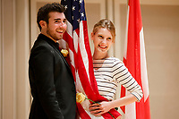 Contestants Zachary Hatcher and Chelsea Lane of the United States pose with the American flag after the opening ceremony of the 11th USA International Harp Competition at Indiana University in Bloomington, Indiana on Wednesday, July 3, 2019. (Photo by James Brosher)