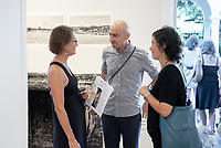 Photographer Bear Guerra and Julia Meltzer, Director of Clockshop.<br /> Opening Reception for South of Fletcher: Stories from the Bowtie, Sept. 13, 2018 at the Weingart Gallery. South of Fletcher: Stories from the Bowtie is a multi-platform storytelling project by Fonografia Collective, produced by Clockshop. Ruxandra Guidi and Bear Guerra have been working at the Bowtie parcel for the past year, talking to people who frequent the site, and learning more about the historic, present day, and potential uses of this unique plot of land next to the LA River. Their research will unfold through a podcast series, three public discussions, and an exhibition of photography at Occidental College. Sponsored by Oxy Arts.<br /> (Photo by Marc Campos, Occidental College Photographer)