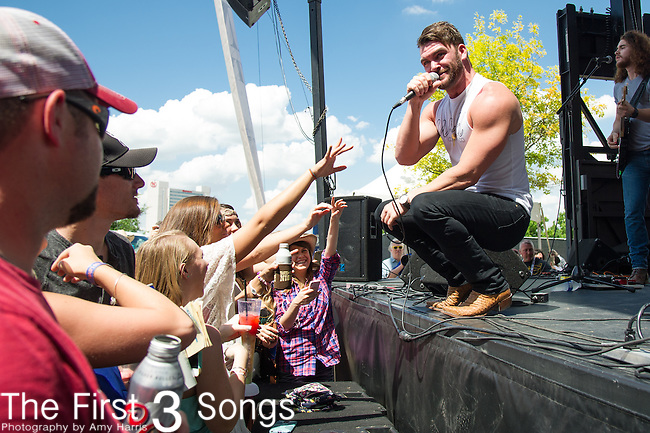 Dylan Scott performs onstage during the ACM Party For A Cause Festival at Globe Life Park on April 18, 2015 in Arlington, Texas.
