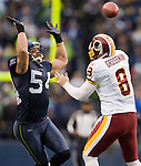 Washington Redskins quarterback Rex Grossman passes under pressure from Seattle Seahawks linebacker David Vabora in the third quarter at  CenturyLink Field in Seattle, Washington on November 27, 2011.  Vabora was flagged for roughing the passer. Redskins stunned the Seattle Seahawks 23-17. ©2011 Jim Bryant Photo. All Rights Reserved.