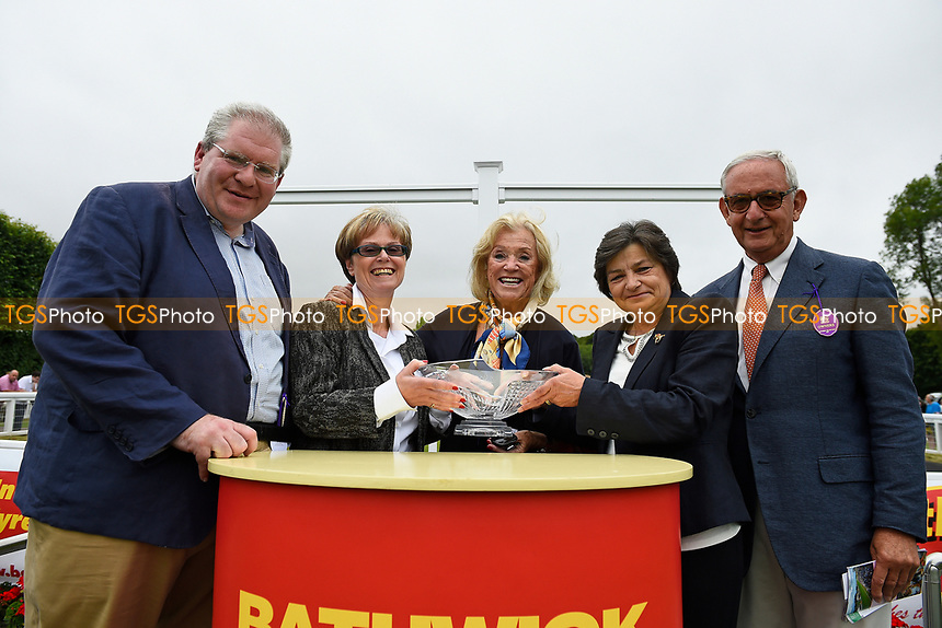 Connections of Beringer receive their trophy for winning The Bathwick Tyres EBF Novice Stakes during Ladies Evening Racing at Salisbury Racecourse on 15th July 2017