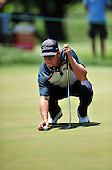 Bethesda, MD - June 29, 2014: Charlie Hoffman lines up a shot on two during the final round of play at the Quicken Loans National at Congressional Country Club in Bethesda MD. Hoffman shot a final-round 69 to tie for third. (Photo by Phillip Peters/Media Images International)