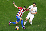 Atletico de Madrid's Yannick Ferreira Carrasco (l) and Real Madrid's Lucas Vazquez during La Liga match. November 19,2016. (ALTERPHOTOS/Acero)