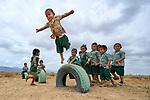 Children practice flying during school recess, Hiowa, Guyana.