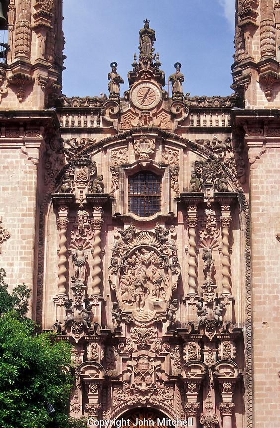 The baroque style facade of Santa Prisca Church in Spanish colonial town of Taxco, Guerrero, Mexico