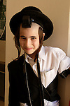 Israel, Bnei Brak. The Synagogue of the Premishlan congregation on Purim holiday, a Hassidic boy in costume, 2005<br />