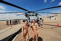 Wisconsin native Major Jodi (Miller) Maroney (right) and her copilot Major Brietta Walker (left) pose with a CH-53 marine helicopter on Wednesday at Wisconsin Aviation in Madison