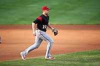 Richmond Flying Squirrels third baseman Christian Arroyo (22) fields a ground ball behind the pitchers mound during a game against the Erie SeaWolves on May 27, 2016 at Jerry Uht Park in Erie, Pennsylvania.  Richmond defeated Erie 7-6.  (Mike Janes/Four Seam Images)