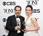 Tony Shalhoub and Katrina Lenk poses in the 72nd Annual Tony Awards Press Room at 3 West Club on June 10, 2018 in New York City.