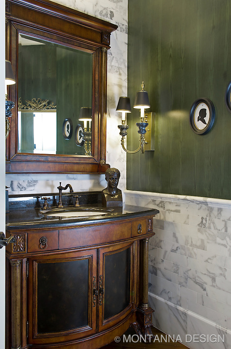Formal powder bath is classic with carrera marble and green faux bois wallcovering.