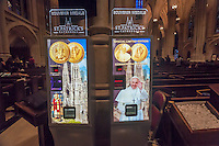 Vending machines in St. Patrick's Cathedral in New York sell souvenir coins including one for Pope Francis' visit on Tuesday, September 15, 2015. Pope Francis, the Holy Father, will pray at the Vespers Service in the Cathedral on Sept. 24th during his U.S. visit. In New York he will visit Central Park and lead a mass at Madison Square Garden. The Pope will be in the U.S. from Sept. 22 visiting Washington DC, New York and Philadelphia.  (© Richard B. Levine)