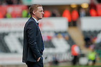 SWANSEA, WALES - APRIL 04: Manager of Swansea City, Garry Monk looks on during the Premier League match between Swansea City and Hull City at Liberty Stadium on April 04, 2015 in Swansea, Wales.  (photo by Athena Pictures)