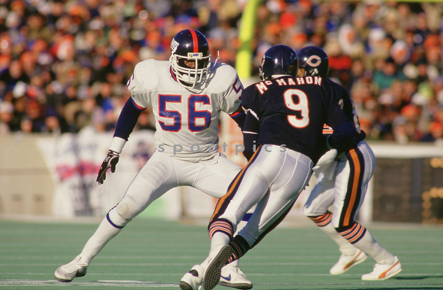 New York Giant Lawrence Taylor (56) during a game from his 1986 season with the Giants. Lawrence Taylor played for 13 years, all with the Giants, was a 10-time Pro Bowler and inducted to the Pro Football Hall of Fame in 1999.(SportPics)