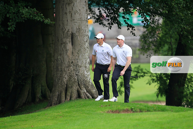 Colm Campbell &amp; Paul Reavey (Warrenpoint) walking up the 1st fairway during the Ulster Final of the AIG Barton Shield at Knock Golf Club in Belfast between Warrenpoint and North West on Sunday 23rd August 2015.<br /> Picture:  Thos Caffrey / www.golffile.ie