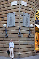 Italian man waiting on corner of Via de Tornabuoni and Via Degli Strozzi in Florence,Tuscany, Italy