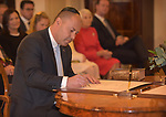 Australian Treasurer Josh Frydenberg signs the writs at Government House, Canberra, Wednesday May 29, 2019. AFP PHOTO/ MARK GRAHAM