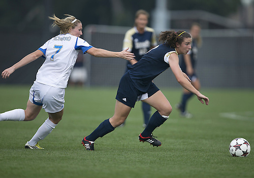 September 01, 2013:  Notre Dame midfielder Morgan Andrews (3) advances the ball as UCLA midfielder Jenna Richmond (7) defends during NCAA Soccer match between the Notre Dame Fighting Irish and the UCLA Bruins at Alumni Stadium in South Bend, Indiana.  UCLA defeated Notre Dame 1-0.