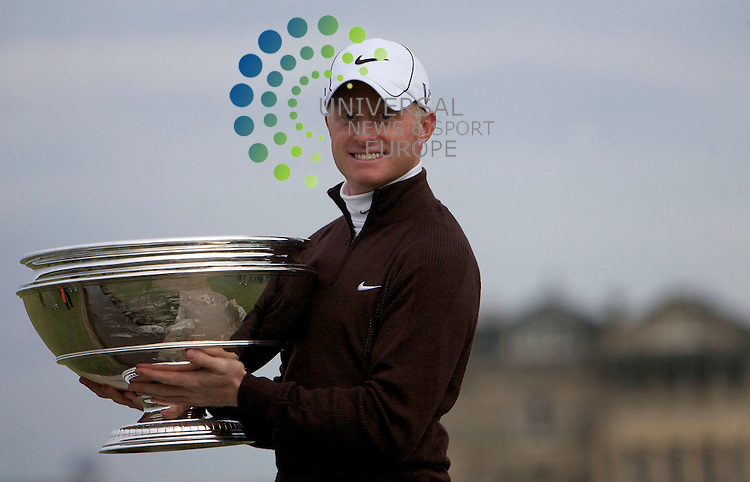 The Alfred Dunhill Golf Championship 2009 at The Old Course, St Andrews, Kingsbarns and Carnoustie.. .Dunhill Winner Simon Dyson on Swilken Bridge with the trophy. After the Gale-Force Delayed Final  Round of the Alfred Dunhill Golf Championship...Picture by Mark Davison/ Universal News & Sport