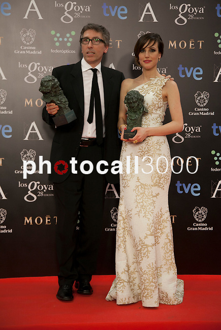 Natalia de Molina holds the award after winning the best revelation actress and David Trueba the best film at the Goya Film Awards photocall in Madrid on February 9, 2014. Photo by Nacho Lopez/ DyD FOTOGRAFOS-DYDPPA