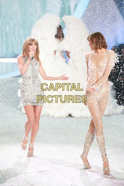 NEW YORK, NY - NOVEMBER 13, 2013: Taylor Swift, Karlie Kloss  at the 2013 Victoria's Secret Fashion Show at Lexington Avenue Armory on November 13, 2013 in New York City, NY., USA.<br /> CAP/MPI/COR<br /> &copy;Corredor99/ MediaPunch/Capital Pictures
