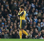 Alex Oxlade-Chamberlain of Arsenal hides his face after coming on as a substitute he is taken off during the English Premier League match at the Etihad Stadium, Manchester. Picture date: December 18th, 2016. Picture credit should read: Simon Bellis/Sportimage