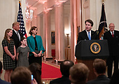 United States President Donald J. Trump, Ashley Kavanaugh, and daughters L:iza and Margaret look on from the left as Associate Justice of the US Supreme Court Brett Kavanaugh, center right, makes remarks after taking the Judicial Oath during a ceremony in the East Room of the White House in Washington, DC on Monday, October 8, 2018.  Kavanaugh formally took the oath on Saturday, hours after he was confirmed by the US Senate.  Former Associate Justice of the Supreme Court Anthony M. Kennedy looks on from the right.<br /> Credit: Ron Sachs / CNP<br /> (RESTRICTION: NO New York or New Jersey Newspapers or newspapers within a 75 mile radius of New York City)