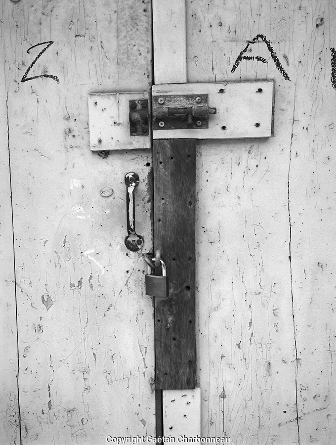 Old wooden door and locks with the letter Z-A-I