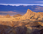 Death Valley National Park, CA<br /> Morning clouds ofer Manly Beacon and the Panamint Mountains, from Zabriskie Point