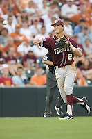 Texas A&M Aggies third baseman Adam Smith #20 throws the ball to first against the Texas Longhorns in NCAA Big XII Conference baseball on May 21, 2011 at Disch Falk Field in Austin, Texas. (Photo by Andrew Woolley / Four Seam Images)
