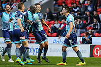 Matthew Bloomfield of Wycombe Wanderers (right) celebrates with team mates after he scores his team's second goal of the game to make it 2-2 during the Sky Bet League 2 match between Doncaster Rovers and Wycombe Wanderers at the Keepmoat Stadium, Doncaster, England on 29 October 2016. Photo by David Horn.