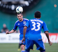 Sam Cronin (4) of the San Jose Earthquakes heads a ball to teammate Steven Beitashour (33) during a Major League Soccer game at RFK Stadium in Washington, DC.  D.C. United defeated San Jose Earthquakes, 1-0.