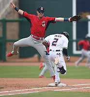 NWA Democrat-Gazette/J.T. WAMPLER Springfield's Zach Kirtley catches the Natural's Nick Heath art second base Sunday June 9, 2019 at Arvest Ballpark in Springdale. The Naturals lost 10-2.