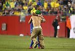 06 June 2008: Robinho (BRA) (behind) is hugged by a fan who ran onto the field. The Venezuela Men's National Team defeated the Brazil Men's National Team 2-0 at Gillette Stadium in Foxboro, Massachusetts in an international friendly soccer match.