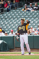 Efren Navarro (14) of the Salt Lake Bees between innings against the Colorado Springs Sky Sox in Pacific Coast League action at Smith's Ballpark on May 24, 2015 in Salt Lake City, Utah.  (Stephen Smith/Four Seam Images)