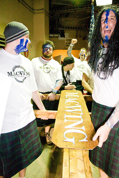 &quot;MacWing&quot; and members of his entourage backstage at the 14th annual Wing Bowl, held in Philadelphia on February 3, 2006 at the Wachovia Center.<br /> <br /> The Wing Bowl is a competitive eating event in which eaters try and down the most hot wings in 30 total minutes in front of a crowd of 10,000 plus people.  The real show however is all around the eaters, from the various scantily clad women (known as &quot;Wingettes&quot;) that make up eaters' entourages, to the behavior of the fans themselves.