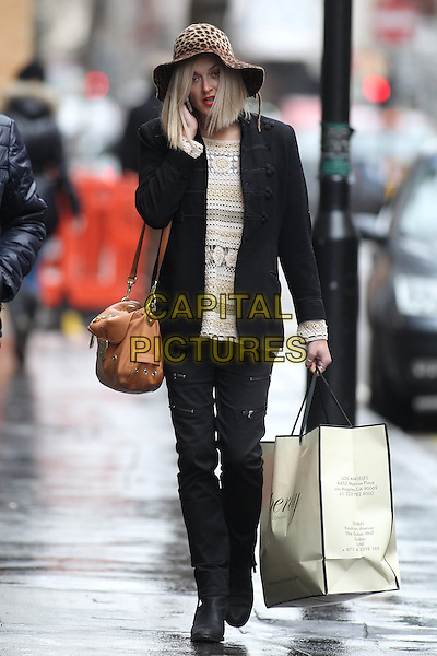 Fearne Cotton leaving the BBC Radio 1 studios, London, England..January 20th, 2011.full length black coat jacket trousers brown leopard print hat white cream beige top bag purse talking on mobile crochet phone .CAP/CAN.©Can Nguyen/Capital Pictures.