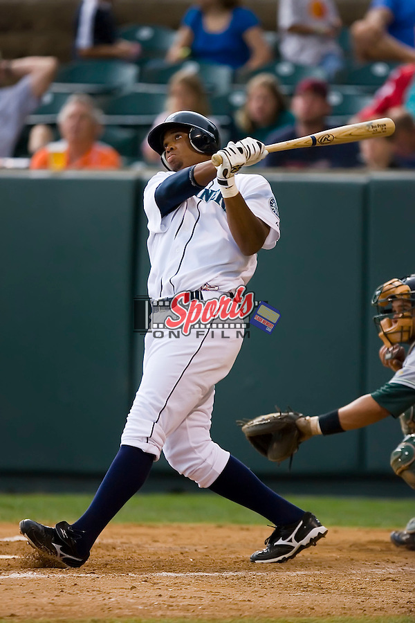 Kalian Sams (20) of the Pulaski Mariners follows through on his 6th home run of the season in the 4th inning versus the Princeton Rays at Calfee Field in Pulaski, VA, Sunday July 6, 2008. (Photo by Brian Westerholt / Four Seam Images)