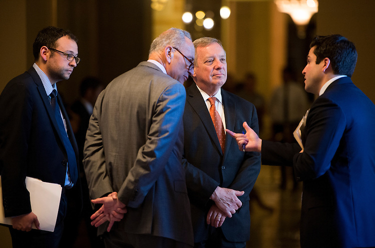 UNITED STATES - JULY 22: Sen. Chuck Schumer, D-N.Y., left, and Sen. Dick Durbin, D-Ill., talk on the second floor of the Capitol on Wednesday, July 22, 2015. (Photo By Bill Clark/CQ Roll Call)