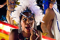 A Cuban girl seen during the makeup refresh done by a choreographer at the Carnival in Santiago de Cuba, Cuba, 26 July 2008. Carnival in Santiago de Cuba is a large public celebration which is held - contrary to the other Latin American carnivals - in the summer. The carnival tradition dates back to the 17th century when the Spanish festival of Santiago (St. James) was mixed with street dancing parades of the Black African slaves. Nowadays comparsas, carnival groups of dancers and musicians, flow in the streets and perform popular music like salsa, rumba or reggaeton. In spite of the general lack of funds in Cuba (most of the festival costumes and floats are home-made) the Carnival is very lively and hot show with huge participation of the people of Santiago de Cuba.