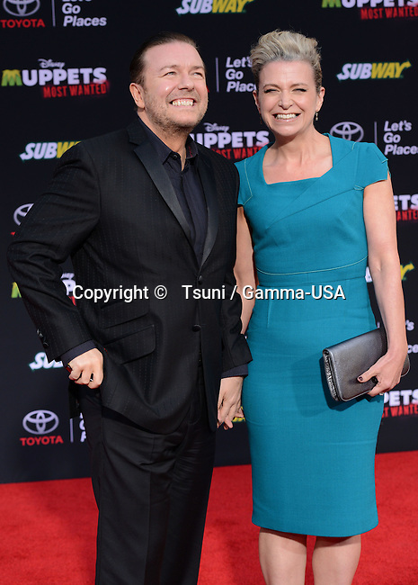 Ricky Gervais, Jane Fallon arriving at the Muppets Most Wanted Premiere at the El Capitan Theatre in Los Angeles.